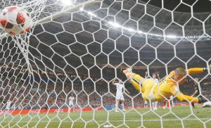 CROATIA'S Ivan Perisic scores his side's first goal past England goalkeeper Jordan Pickford during the semifinal match between Croatia and England at the 2018 soccer World Cup in the Luzhniki Stadium in Moscow on Wednesday. Croatia advanced to its first-ever World Cup Final on Sunday against France with the 2-1 victory over England. THE ASSPCIATED PRESS