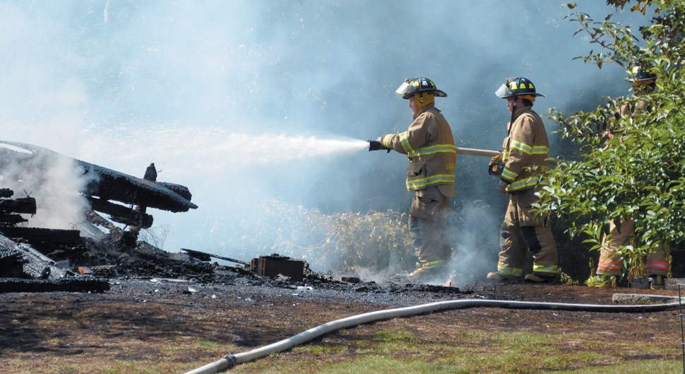 """FIREFIGHTERS battled a fire that destroyed a barn on Millay Road Saturday afternoon but kept the fire from spreading to another barn and to a nearby house. The blaze was reported shortly after 3 p.m. at 164 Millay Road. Flames were already ripping through the 80- year-old barn when the first firefighters arrived. The barn is a complete loss and the cause of the fire is under investigation. """"It is believed it was an accidental cause but we're still looking into it,"""
