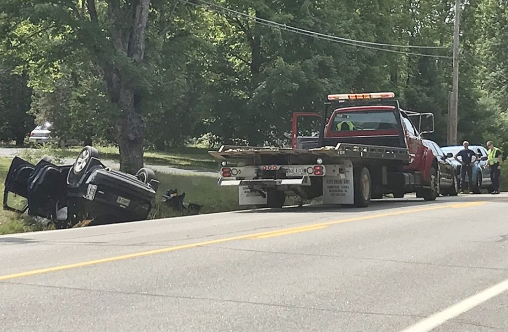 A Jeep Patriot sport utility vehicle crashed on the side of Route 27 in Pittston on Wednesday morning, sending three to the hospital. Maine State Police say distracted driving caused the crash.