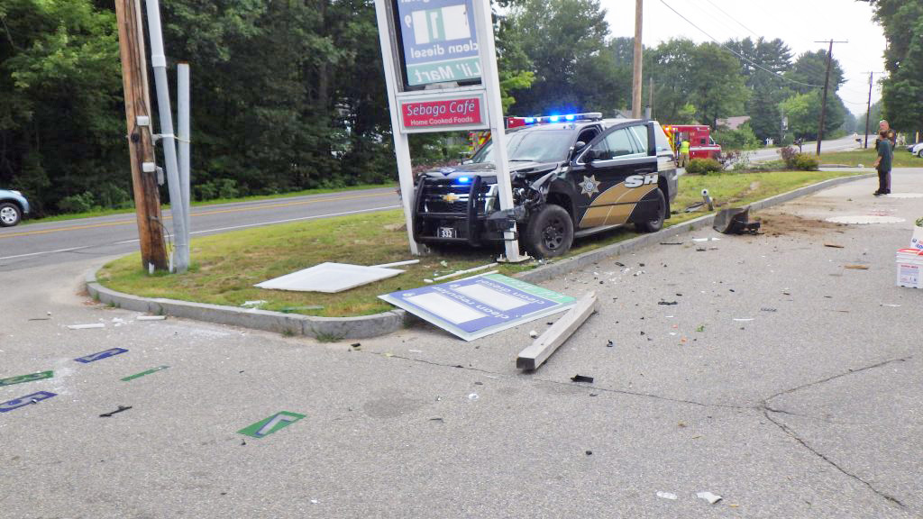 This cruiser struck another car and a sign during a wreck in Windham.