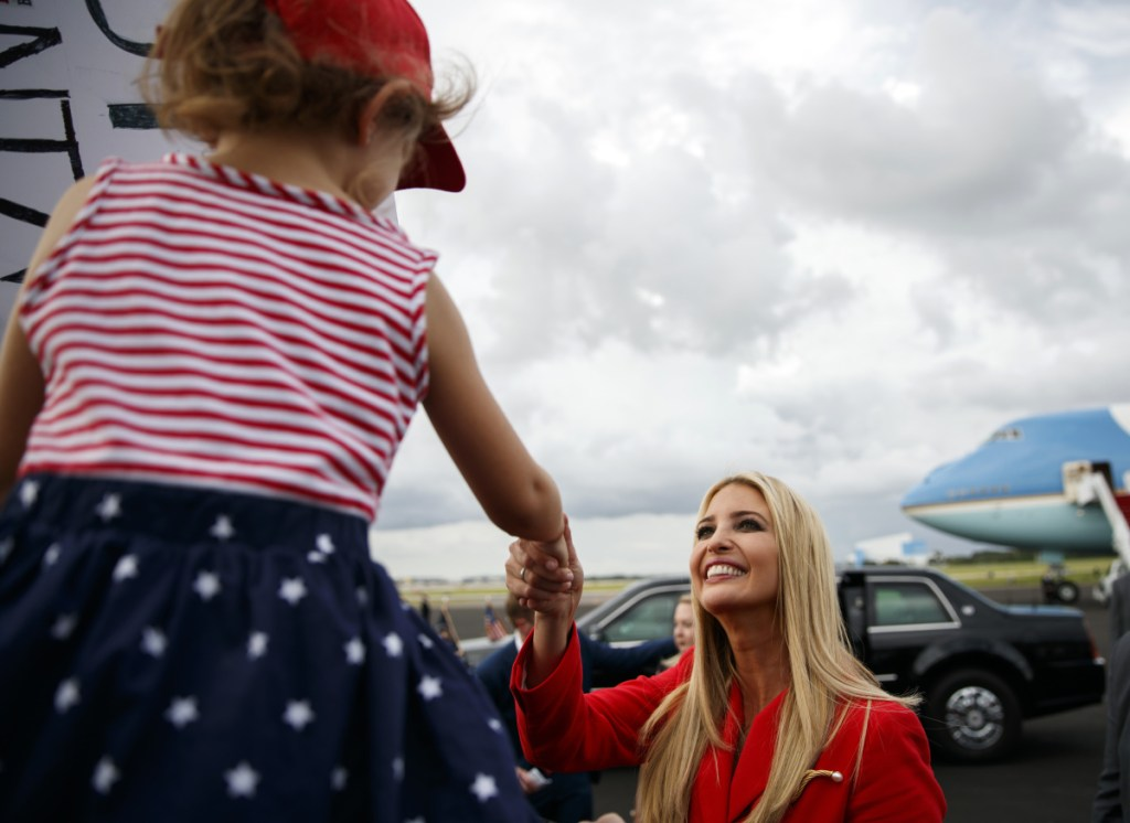 "Ivanka Trump greets a child at Tampa International Airport on Tuesday. Trump says she disagrees with the president's attacks on journalists as the ""enemy of the people."""