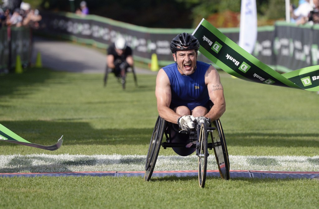 Tony Nogueira of New Jersey crosses the finish line to win the wheelchair division of the Beach to Beacon on Saturday.