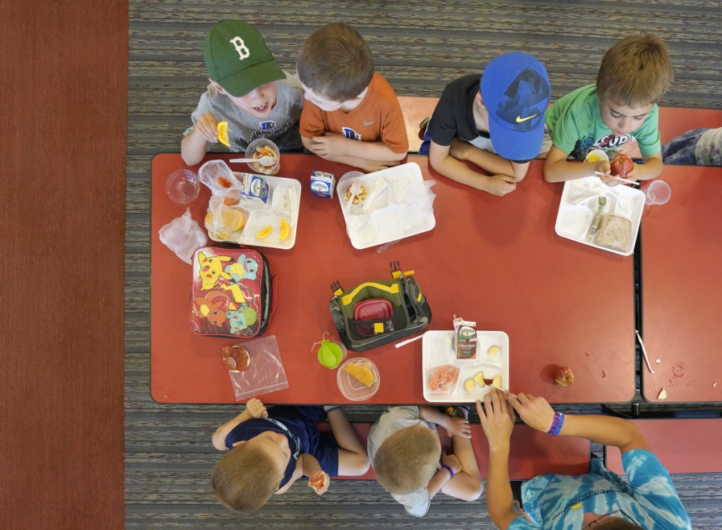 Children in the Buxton summer recreational program eat lunch at Buxton Center Elementary School cafeteria last month. About one in five kids in Maine struggle with food insecurity, more than in any other New England state and more than the average across the United States.