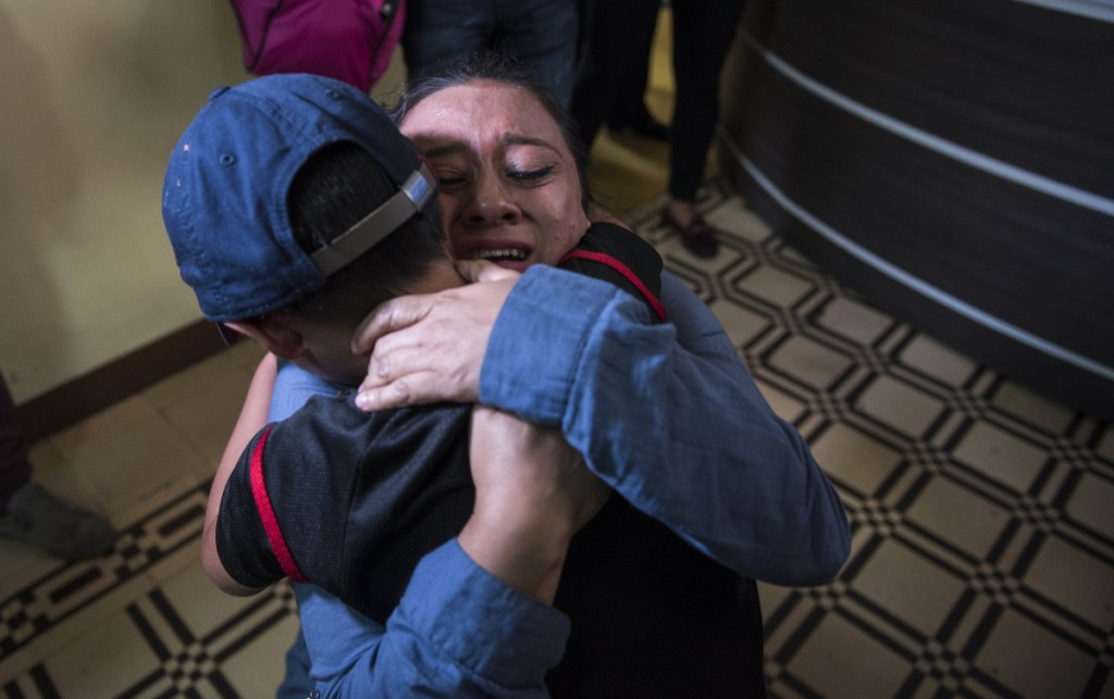 Lourdes de Leon hugs her son Leo Jeancarlo de Leon, 6, as they are reunited in Guatemala City on Tuesday. The Trump administration has been ordered to return more than 2,500 separated children back to their families, but hundreds remain apart after the deadline.