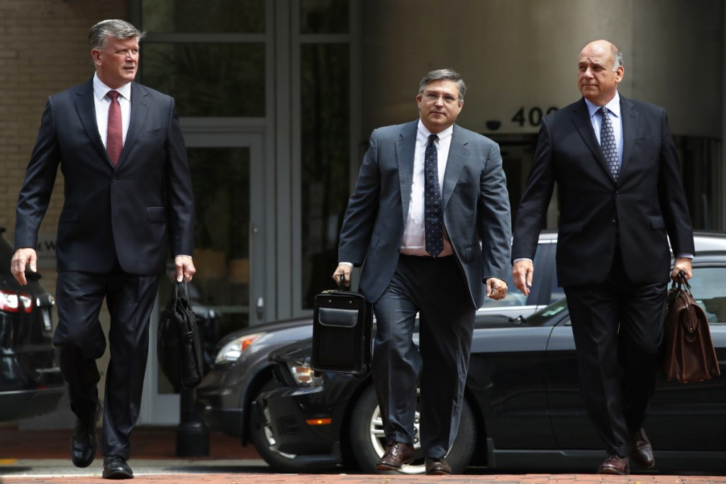 Members of the defense team for Paul Manafort, including Kevin Downing, left, Richard Westling, and Thomas Zehnle, walk to federal court as the trial of the former Trump campaign chairman continues, in Alexandria, Va., on Monday. The prosecution rested its case in the fraud trial Monday.