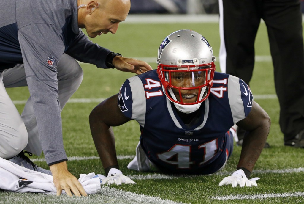 New England Patriots cornerback Cyrus Jones receives attention on the field after an injury during the first half of an NFL preseason football game against the New York Giants, Thursday, Aug. 31, 2017, in Foxborough, Mass. ()
