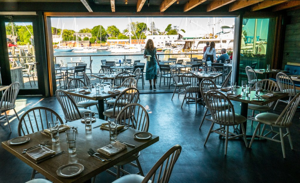 The Hoxbill dining room and deck afford spectacular views of Camden Harbor.
