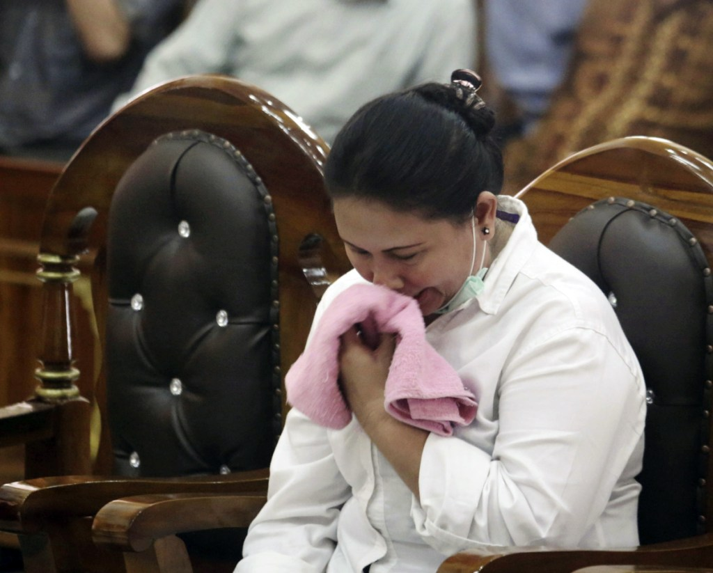 Meiliana weeps during her sentencing hearing at a district court in Medan, North Sumatra, Indonesia, on Tuesday. She got 18 months in prison.