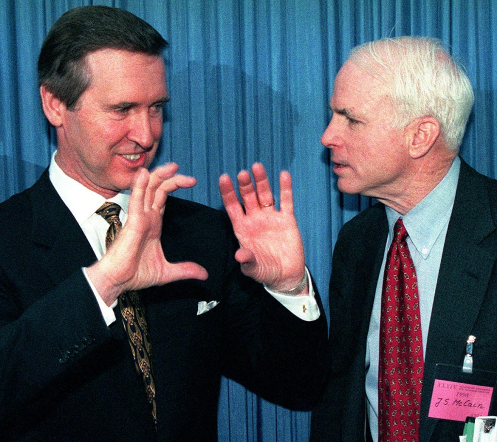 Secretary of Defense William Cohen, left, speaks to Sen. John McCain at a security conference in Munich in 1998.