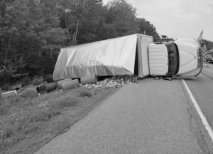 A BAIT TRUCK overturned in Newcastle on Thursday, spilling its load of fish onto Route 1. PHOTO COURTESY OF LINCOLN COUNTY EMERGENCY MANAGEMENT AGENCY