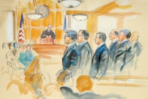 THIS COURTROOM SKETCH depicts Paul Manafort, fourth from right, standing with his lawyers in front of U.S. district Judge T.S. Ellis III, center rear, and the selected jury, seated left, during the jury selection of his trial at the Alexandria Federal Courthouse in Alexandria, Va., Tuesday. DANA VERKOUTEREN VIA AP