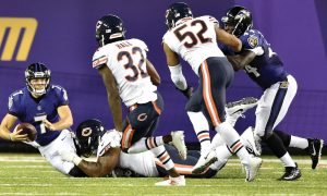 BALTIMORE RAVENS quarterback Josh Woodrum (7) is sacked in the first half against the Chicago Bears at the Pro Football Hall of Fame NFL preseason game on Thursday in Canton, Ohio. The Ravens won, 17-16. THE ASSOCIATED PRESS