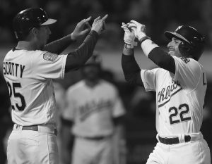 OAKLAND ATHLETICS players Ramon Laureano, right, celebrates with Stephen Piscotty after hitting a three-run home run off Texas pitcher Bartolo Colon in the sixth inning of a baseball game on Monday in Oakland, Calif. THE ASSOCIATED PRESS