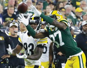 GREEN BAY PACKERS cornerback Josh Jackson intercepts a pass in front of Pittsburgh's Damoun Patterson and returns it for a touchdown during the second half of a preseason NFL football game on Thursday in Green Bay, Wis. THE ASSOCIATED PRESS