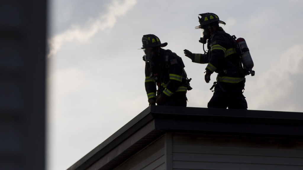 The city's deal with the local union that represents about 200 firefighters increases pay for new hires and gives Portland officials time to do a review of the department.