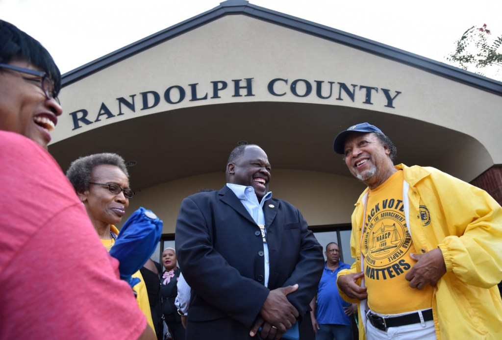 Edward DuBose of the NAACP, center, and others at Randolph County Government Center rejoice after a panel defeated an effort to close rural voting sites in Cuthbert, Ga. Municipalities across the U.S. have closed more than 800 polling places since 2013.