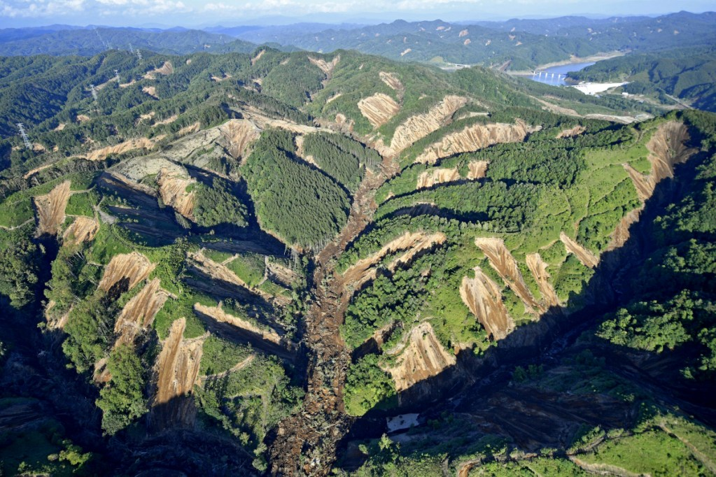 This aerial photo taken on Thursday shows the site of a landslide triggered by an earthquake in Atsuma town, Hokkaido, southern Japan.