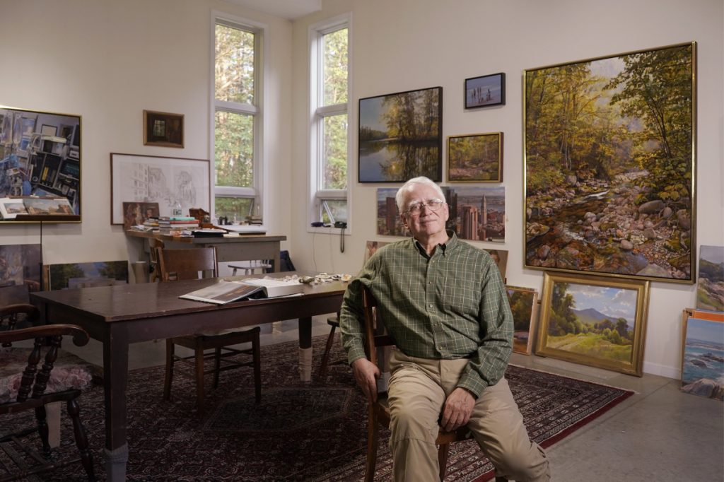 Artist Joel Babb poses for a photo in his studio in Sumner on August 24.