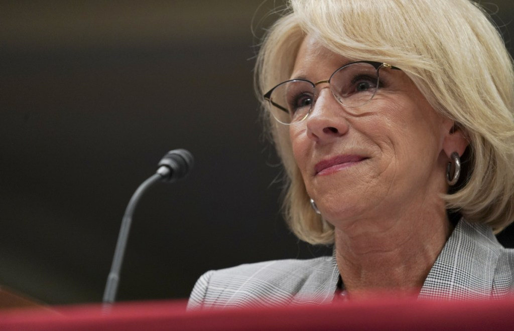 Education Secretary Betsy DeVos appears to be favoring for-profit colleges over their former students who were defrauded.