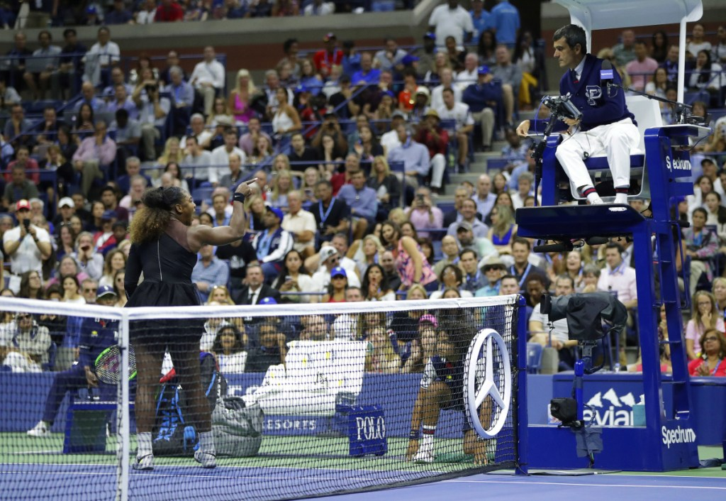 Serena Williams argues with chair umpire Carlos Ramos during a match against Naomi Osaka in the women's final of the U.S. Open on Saturday in New York. Williams lost the match 6-2, 6-4.