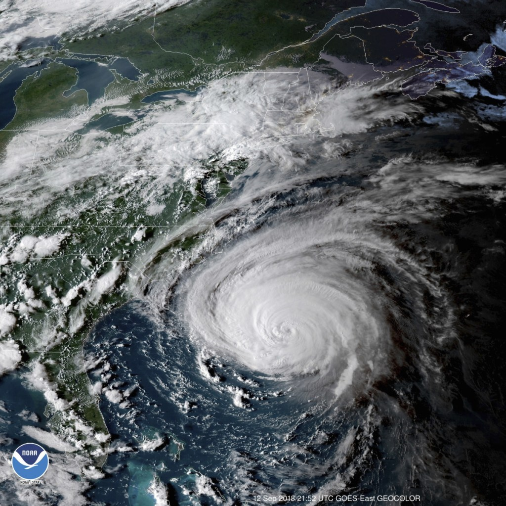 This enhanced satellite image made available by the National Oceanic and Atmospheric Administration shows Hurricane Florence off the eastern coast of the United States on Wednesday at 5:52 p.m.