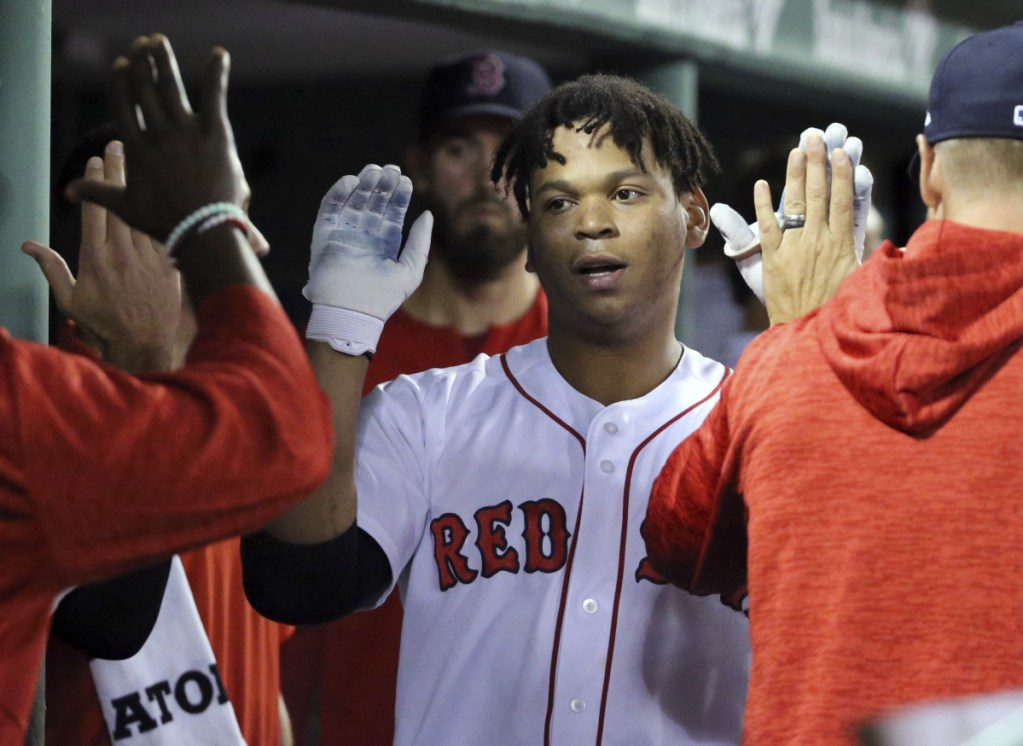 Boston's Rafael Devers celebrates his solo home run in the sixth inning Thursday night against the Toronto Blue Jays at Fenway Park. The Red Sox won, 4-3.
