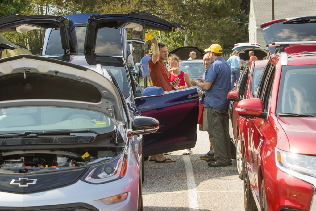 Owners of electric cars share their vehicles with people attending an electric-car event at the South Portland Community Center in September. Financial incentives announced Thursday by Gov. Janet Mills aim to make more Mainers electric-car owners.