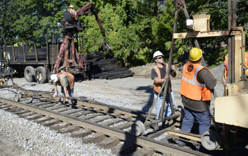 Crews work on the railroad in Portland recently as part of a project to replace 15,000 rail ties between Dover, N.H., and Brunswick. It is one of the rail improvements leading up to an expansion of Amtrak's Downeaster passenger service to five round trips a day between Boston and Brunswick, expected to begin in late November.