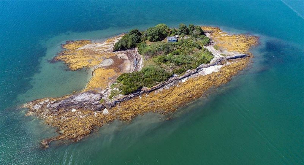 Crab Island, up for sale for the first time in 65 years, appears to have a buyer. It has a two-bedroom cottage and was once owned by Robert Peary.