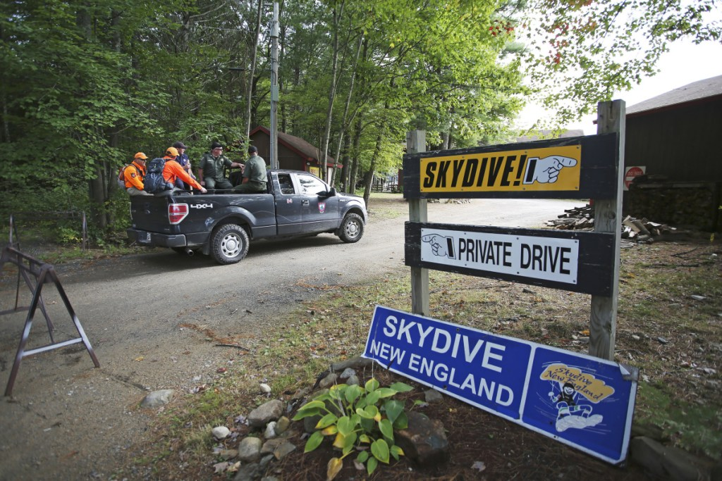 Members of the Maine Warden Service head out on Sept. 28 to search for the body of Brett Bickford, a skydive instructor who reportedly got detached from his student during a tandem jump a day earlier.
