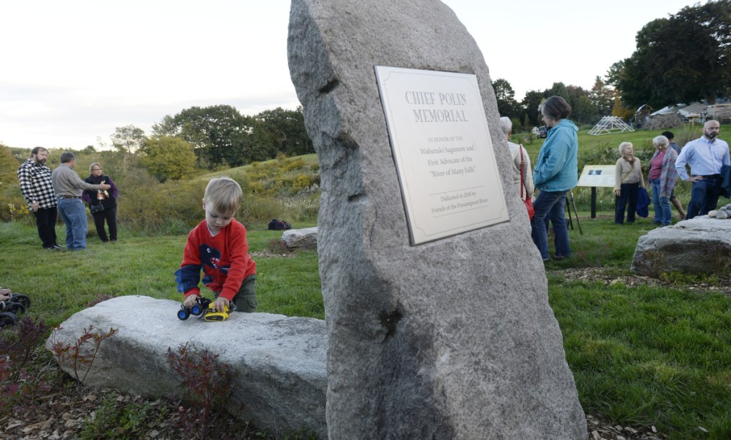 Aebel Shaughnessy, 3, of Westbrook plays at the memorial garden honoring Chief Polin and the First People of the Presumpscot River before its dedication Saturday in Westbrook.