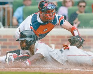 BOSTON RED SOX Brandon Phillips slides home safely to score past Atlanta Braves catcher Tyler Flowers during the eighth inning of a baseball game on Wednesday in Atlanta. Phillips homered in the ninth to propel the Red Sox to a thrilling 9-8 come-from-behind victory. THE ASSOCIATED PRESS