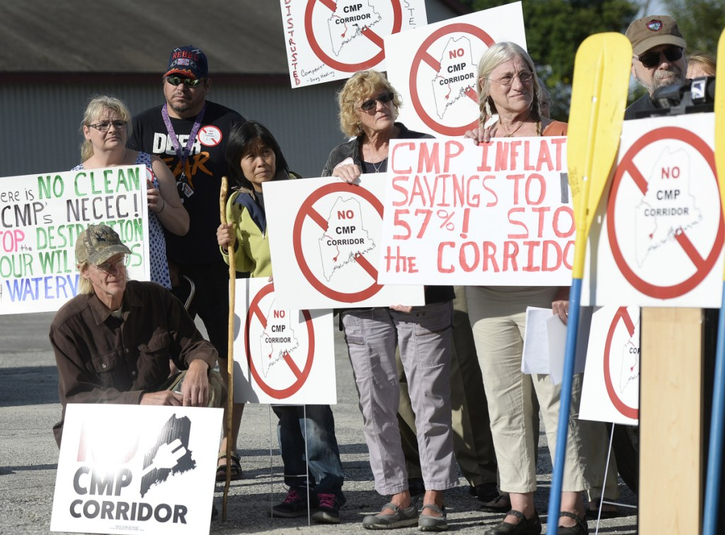 Protesters participate in the Say NO to NECEC rally last September in Augusta. The Franklin County commissioners voted to rescind their approval of the CMP transmission line project at their meeting Tuesday.