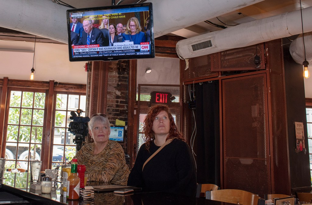 Customers watch the testimony of Christine Blasey Ford at Shaw's Tavern on Thursday in Washington, D.C.