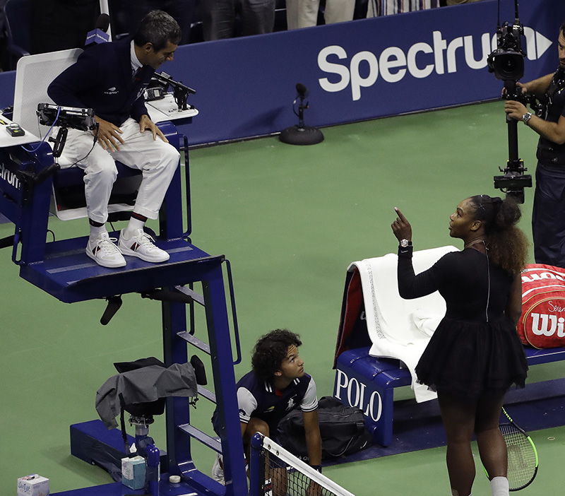 Serena Williams confronts with chair umpire Carlos Ramos at the end of the women's final of the U.S. Open tennis tournament on Saturday.