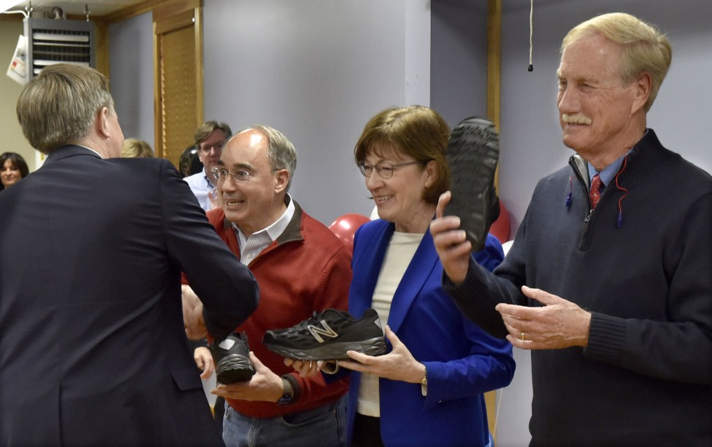 Sen. Angus King holds up a New Balance athletic shoe as Dave Wheeler, left, of the company hands Sen. Susan Collins and  Rep. Bruce Poliquin their own shoes Tuesday in Norridgewock. Both Collins and King said they oppose President Trump's plan to issue an executive order revoking birthright citizenship. Poliquin did not take a position on the proposal.