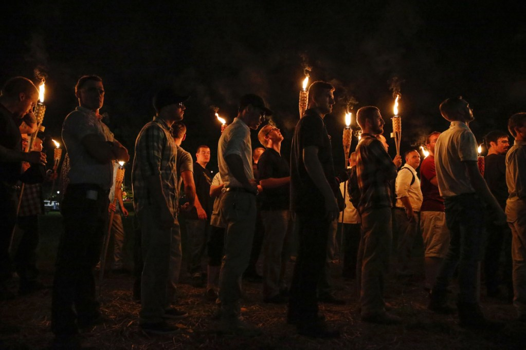 Multiple white nationalist groups march with torches through the University of Virginia campus in Charlottesville, Virginia, on Aug. 11, 2017. Four arrests have been made in connection with a white nationalist march and rally.