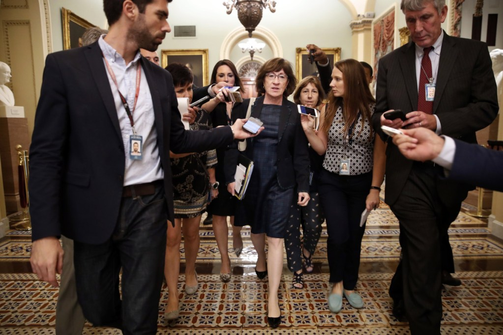 Reporters swarm Sen. Susan Collins last week on Capitol Hill. Political observers say Maine voters' level of engagement on President Trump's latest Supreme Court nominee is unprecedented, and the focus on the up-or-down vote by Maine's Republican senator has been intense.