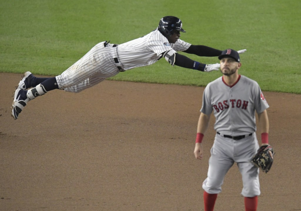 Didi Gregorius of the Yankees dives into second base after hitting a double against Boston in the ALDS on Tuesday. Gregorius needs Tommy John surgery.