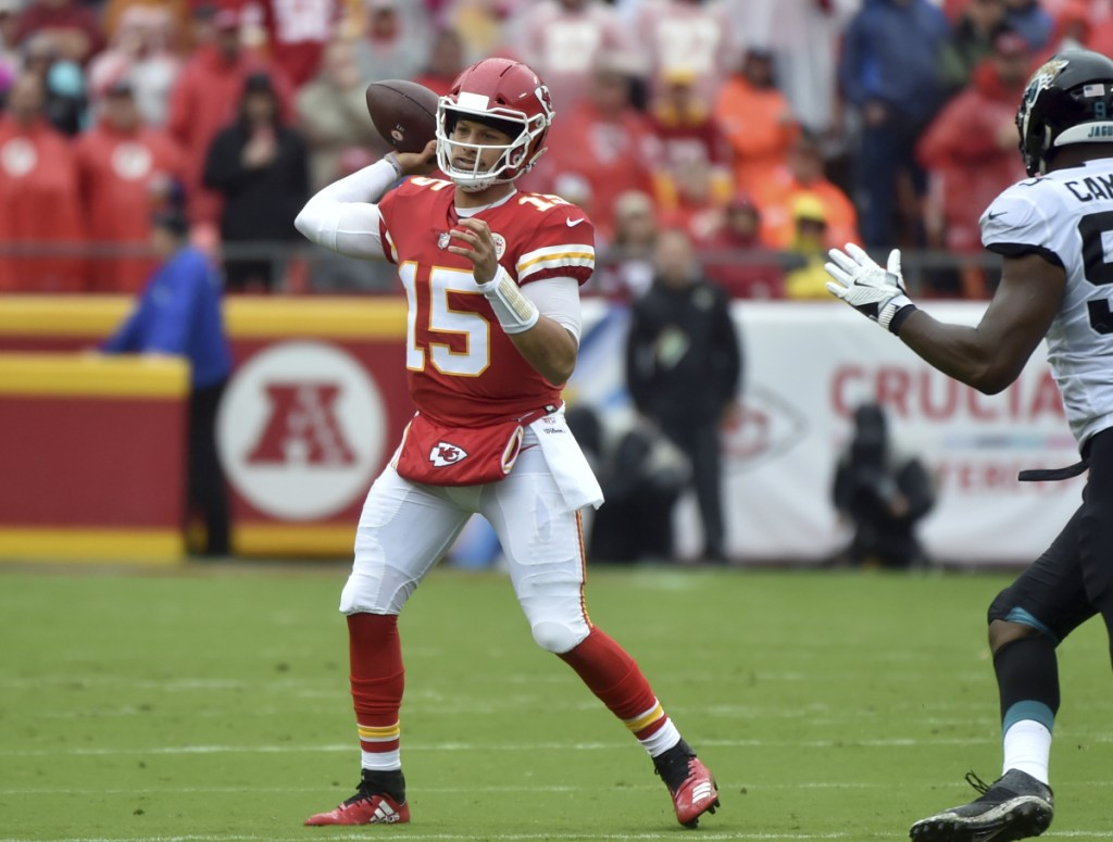 Kansas City Chiefs quarterback Patrick Mahomes (15) throws a pass during the first half of an NFL football game against the Jacksonville Jaguars in Kansas City, Mo., Sunday, Oct. 7, 2018. (AP Photo/Ed Zurga)