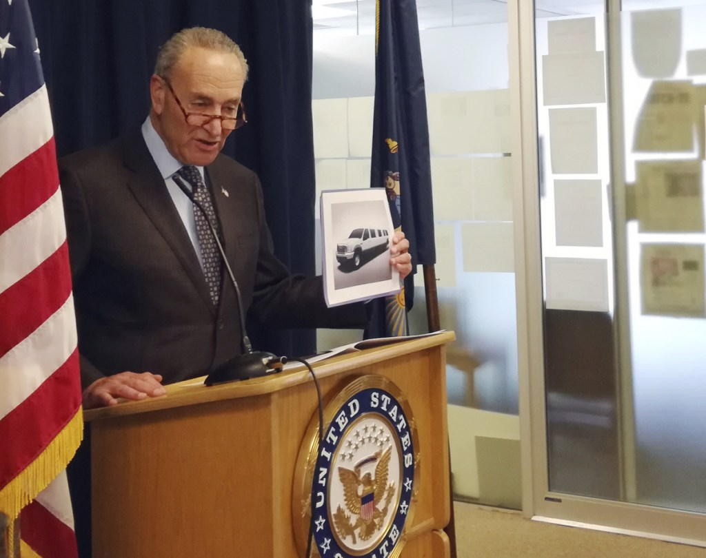 Sen. Chuck Schumer, D-NY, holds a photo of a stretch limousine during a news conference in New York in which he pointed to glaring gaps in safety data that he says exist because federal officials have not done enough to investigate limo wrecks. (Associated Press/Julie Walker)