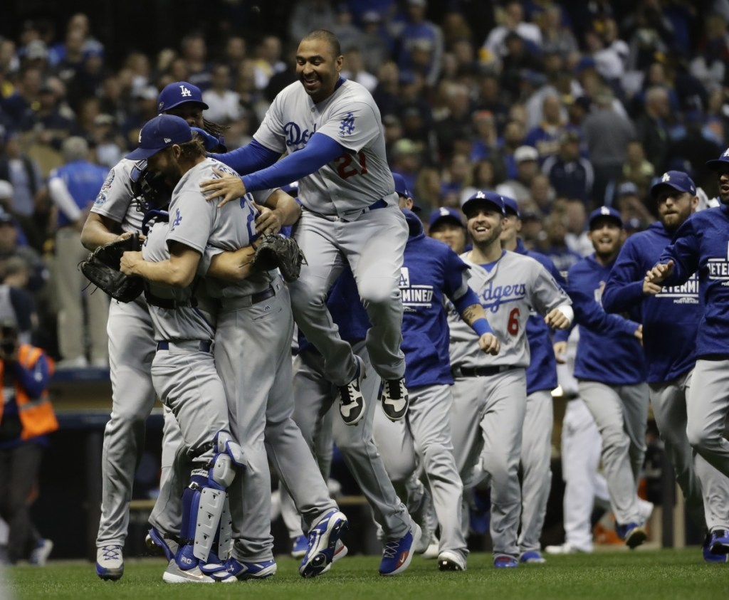 The Los Angeles Dodgers celebrate after Game 7 of the National League Championship Series on Saturday in Milwaukee. The Dodgers won 5-1 to win the series.
