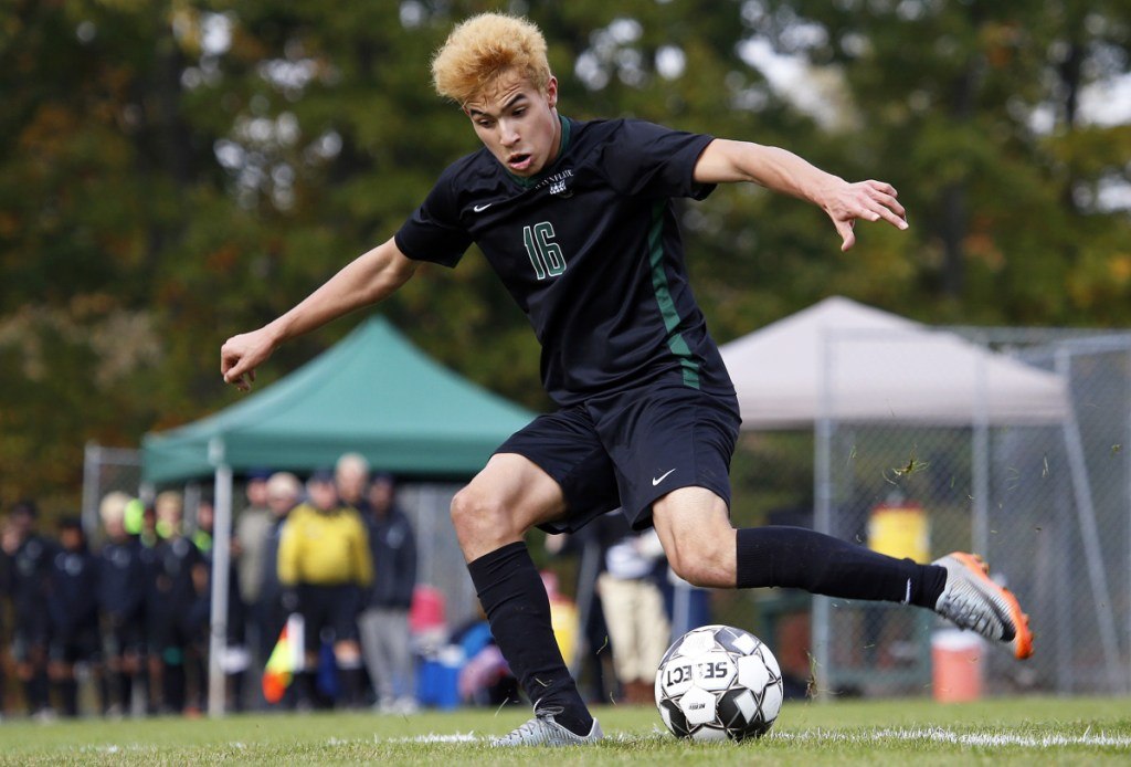 Waynflete's Pat Shaw takes a shot on goal on Tuesday during a Class C South boys' soccer quarterfinal against Sacopee Valley in Portland. Shaw set up the Flyers' second goal of the game in the 4-0 win.
