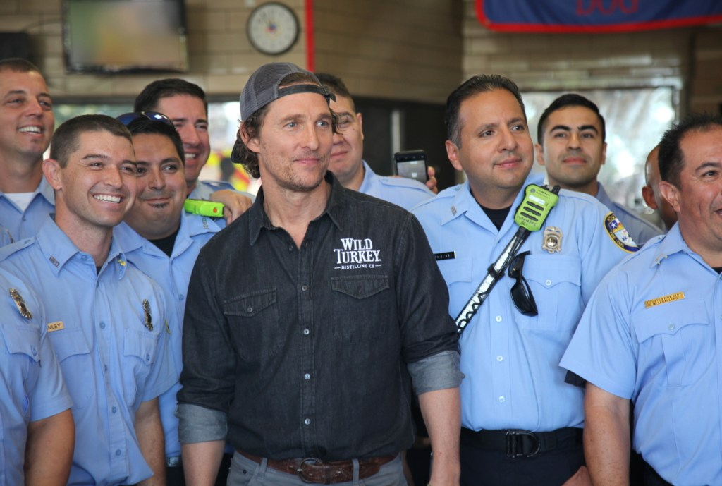 Actor Matthew McConaughey poses with first responders in Houston as he surprised them with catered lunches.