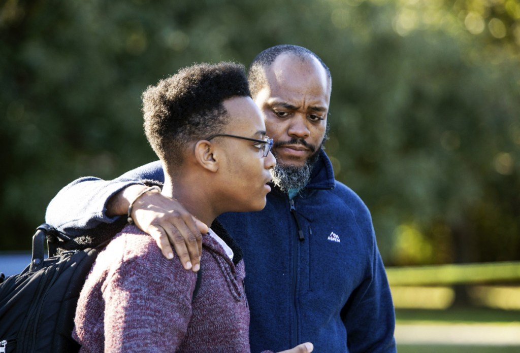 "Gavriel Fulcher-Daniels, left, and Stephen Daniels talk with members of the media after a deadly shooting at Butler High School in Matthews, N.C., Monday. ""It sounded like a balloon but louder,"" Fulcher-Daniels said, after hearing a gunshot."