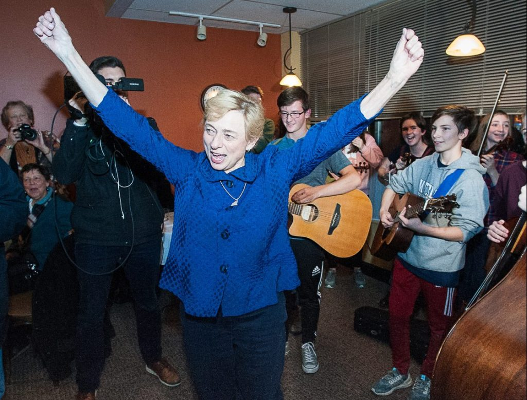 Janet Mills reacts as she enters The Homestead Kitchen, Bar & Bakery on Wednesday night in downtown Farmington, where dozens more people were waiting inside to welcome home the governor-elect.