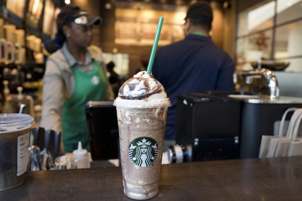 In this June 20 file photo, a Venti Mocha Frappuccino is displayed at a Starbucks. Starbucks served up its holiday cup designs Thursday.