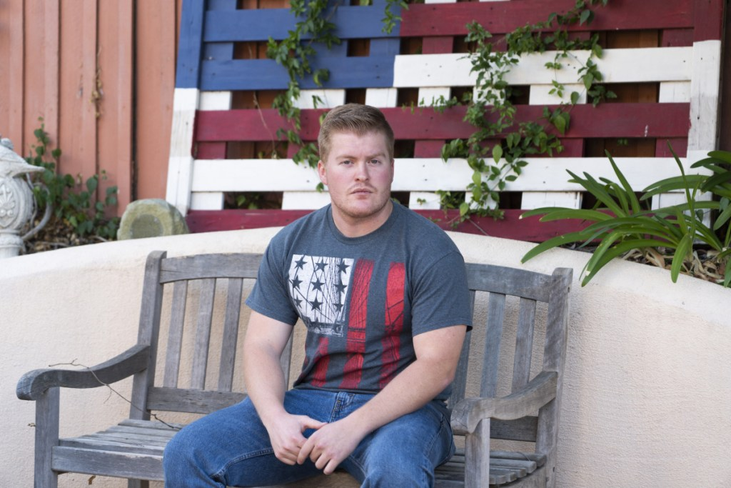 David Anderson, 23, a survivor of the mass shooting at Borderline Bar & Grill and the 2017 Las Vegas shooting at the Route 91 Harvest music festival, sits outside of his home.