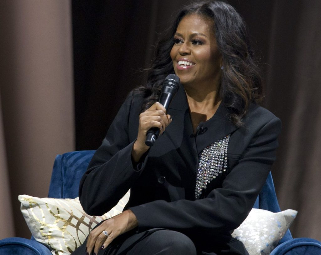 """Michelle Obama talks in Washington about her new memoir, """"Becoming."""" Obama topped Gallup's annual poll of most admired women."""