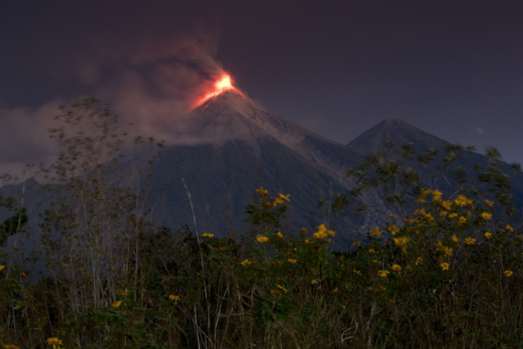 The Volcan de Fuego, or Volcano of Fire, spews hot molten lava from its crater in Escuintla, Guatemala, early Monday. Disaster coordination authorities have asked several communities to evacuate and go to safe areas after its second eruption in six months. (AP Photo/Moises Castillo)